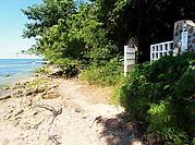 ON A SECLUDED COVE: private gateway steps off the water's edge onto TWO-ACRES of prime waterfront - one or both Lots on offer..