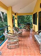 Enjoy tropical breezes and wildlife along the river from your balcony..
