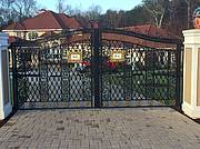 Grand front entrance with electric gates..
