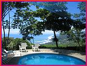 The spectacular coastline view from Dominicalito beach all the way to Manwell Antonio State Park, as seen from the swimming pool and Rancho...