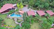 Aerial view of Main house and 3 casitas by the river..