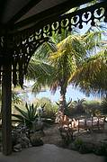 A COOL PORCH and secluded garden shaded by mature coconut trees and overlooking the expanse of Sparrow Bay. An authentic Caribbean ambience for al fresco dining...