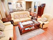 Living room comes in genuine leather sofa seats. 3-tonner floor standing Airconditioning to cool living room and kitchen...