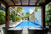 Gorgeous pool with tropical gardens, ample loungers, bathrooms and BBQ pallapa area...